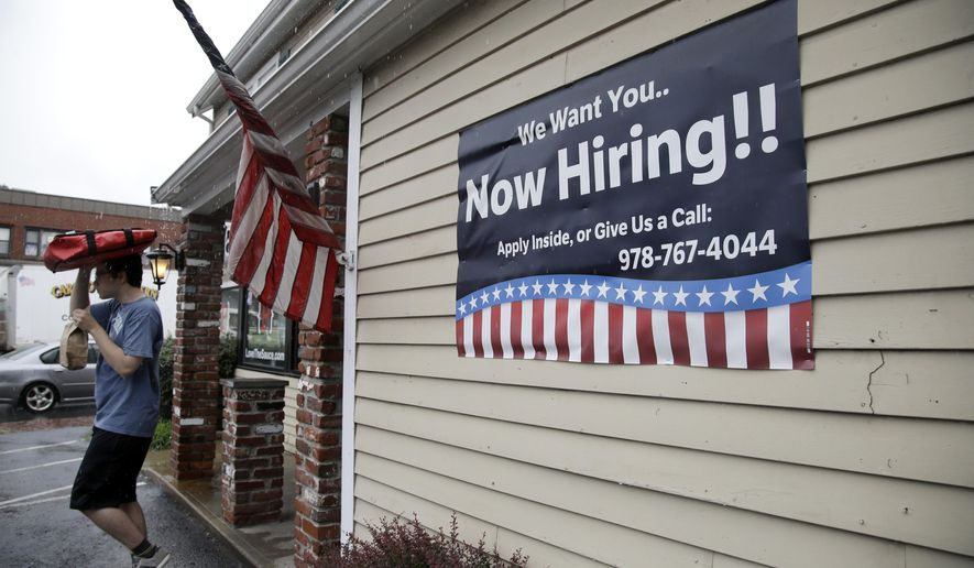 FILE - In this July 24, 2017, file photo, a sign advertising employment hangs outside a restaurant in Middleton, Mass. The number of Americans applying for unemployment benefits rose by 12,000 the week of Sept. 18, to 272,000 as Florida continued to absorb the economic impact of Hurricane Irma. (AP Photo/Elise Amendola, File)