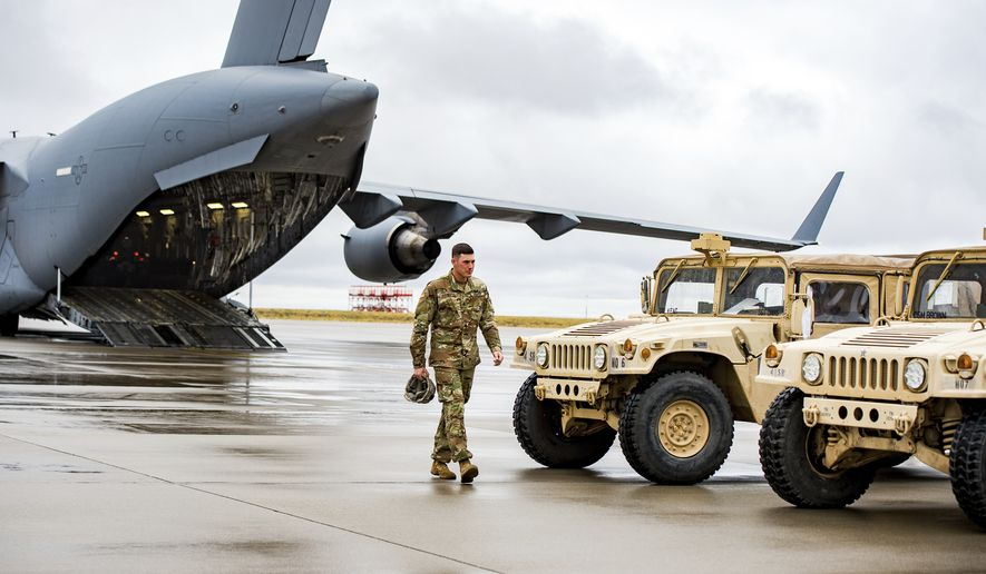 A solider walks out of the C-17 Loadmaster as various supplies and military vehicles were loaded inside as approximately 150 4th Sustainment Brigade, 4th Infantry Division soldiers were deployed to Puerto Rico and the Virgin Islands to provide sustainment support to Hurricane Maria Relief efforts at Fort Carson ADAC/G on Friday Sept. 29, 2017 in Colorado Springs, Colo. (Dougal Brownlie/The Gazette via AP)