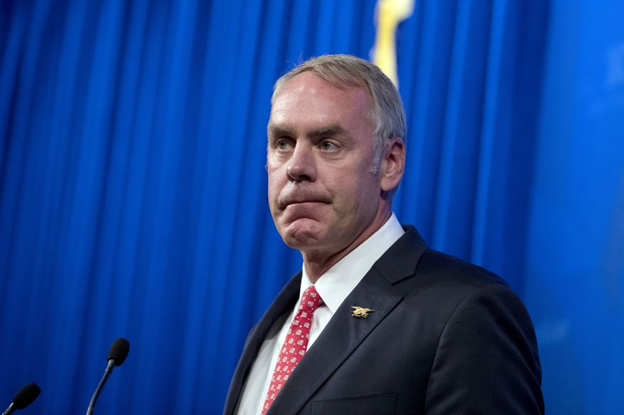 Interior Secretary Ryan Zinke speaks about the Trump Administration's energy policy at the Heritage Foundation in Washington, Friday, Sept. 29, 2017.  (AP Photo/Andrew Harnik)