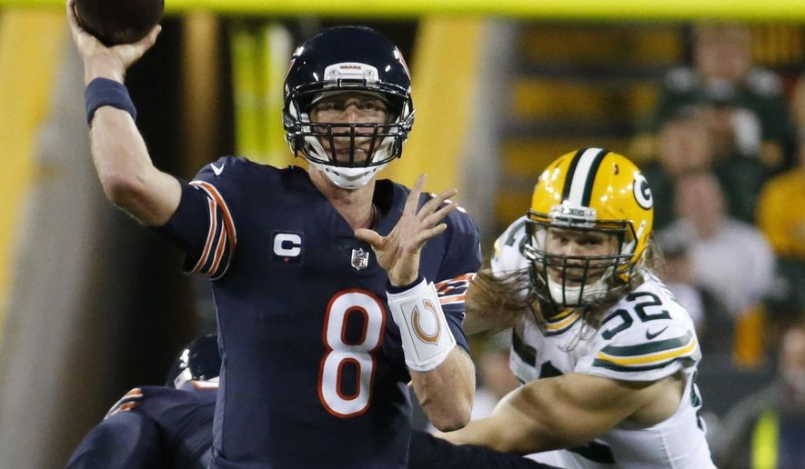 Chicago Bears' Mike Glennon throws in front of Green Bay Packers' Clay Matthews during the second half of an NFL football game Thursday, Sept. 28, 2017, in Green Bay, Wis. (AP Photo/Mike Roemer) **File**