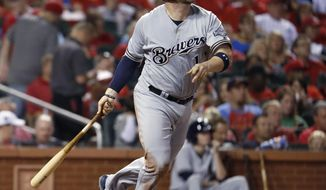 Milwaukee Brewers' Stephen Vogt watches his solo home run during the fourth inning of a baseball game against the St. Louis Cardinals on Friday, Sept. 29, 2017, in St. Louis. (AP Photo/Jeff Roberson)