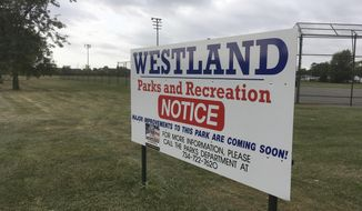In this Wednesday, Sept. 27, 2017, a park improvement sign is displayed at Voss Park in Westland, Mich. The park is getting upgrades with $300,000 in the new state budget. The money was secured by state Rep. Bob Kosowski, a Westland Democrat who serves on the House Appropriations Committee. The budget reflects some of the very local desires of legislators who serve on the committee. (AP Photo/Ed White)