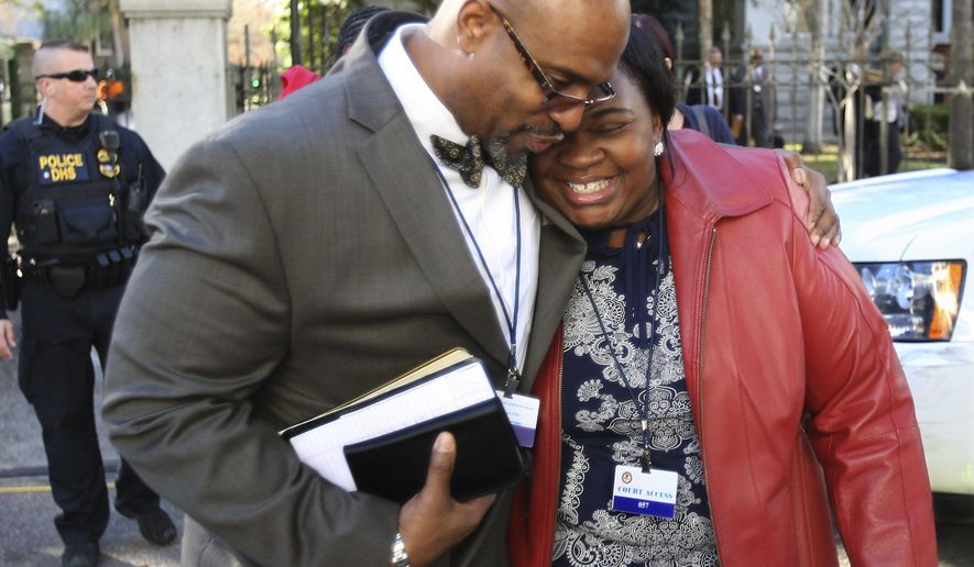FILE - In this Jan. 11, 2017 file photo, the Rev. Eric Manning, pastor at Emanuel AME, leaves the Federal Court House after the death sentence hearing for Dylann Roof in Charleston, S.C.   Manning said on Sept. 28, race relations in the United States may be regressing, pointing to the white nationalist rally in Charlottesville, Virginia, in August. Manning said he hopes the country can use the same strength, resolve and faith that Charleston used after the church shooting to address racial inequality.(Leroy Burnell/The Post And Courier via AP)