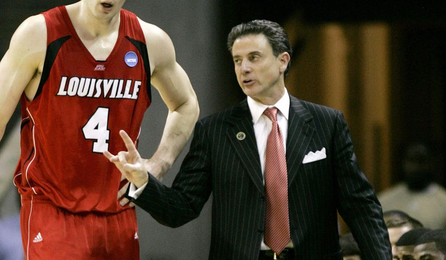 FILE - In this March 29, 2008, file photo, Louisville head coach Rick Pitino talks to David Padgett during an NCAA East Regional final basketball game in Charlotte, N.C. Louisville has named assistant David Padgett as the interim replacement for men's basketball coach Rick Pitino, staying in-house to maintain continuity in the wake of a nationwide federal investigation of college basketball.  (AP Photo/Gerry Broome, File)