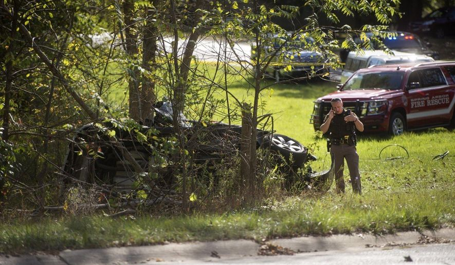 In this Thursday, Sept. 28, 2017 photo, police and emergency personnel respond to the scene of a fatal two car crash in Jackson, Mich. (Claire Abendroth /Jackson Citizen Patriot via AP)