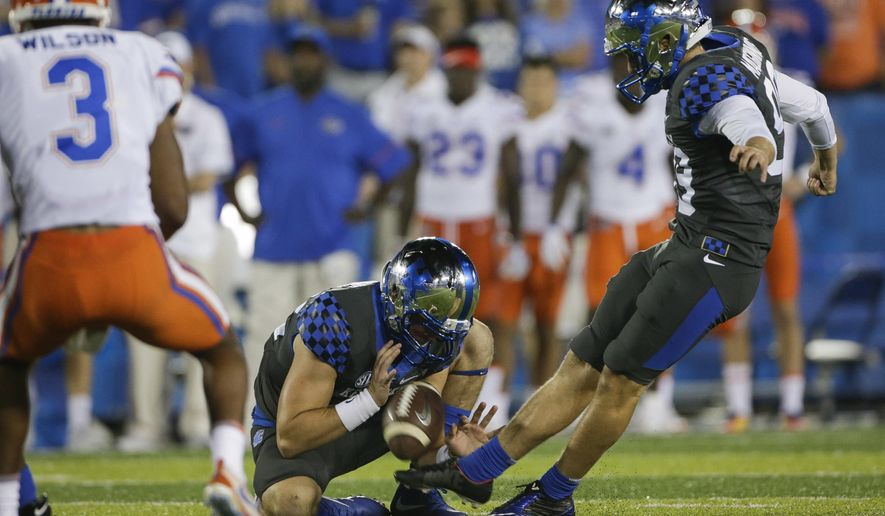 Kentucky's Austin MacGinnis kicks a field goal during the second half of an NCAA college football game against Florida on Saturday, Sept. 23, 2017, in Lexington, Ky. Florida won 28-27. (AP Photo/David Stephenson)
