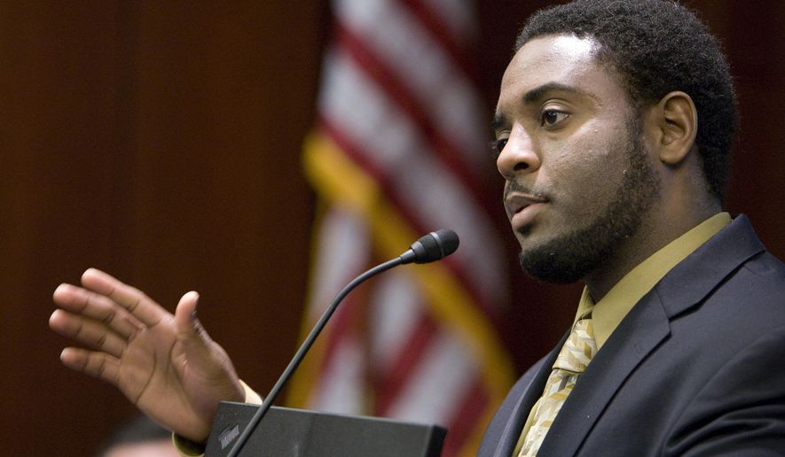 "FILE - In this Nov. 5, 2009 file photo, Reginald Dwayne Betts, writing workshop program director, speaks during a school forum on Capitol Hill in Washington. Betts, a convicted felon who graduated from Yale Law School and won acclaim as a poet, was admitted to the state bar Friday, Sept. 29, 2017, by the Connecticut Bar Examining Committee. The panel previously had flagged his file after he passed the bar exam to investigate whether he lacked ""good moral character and/or fitness to practice law."" (AP Photo/Alex Brandon, File)"