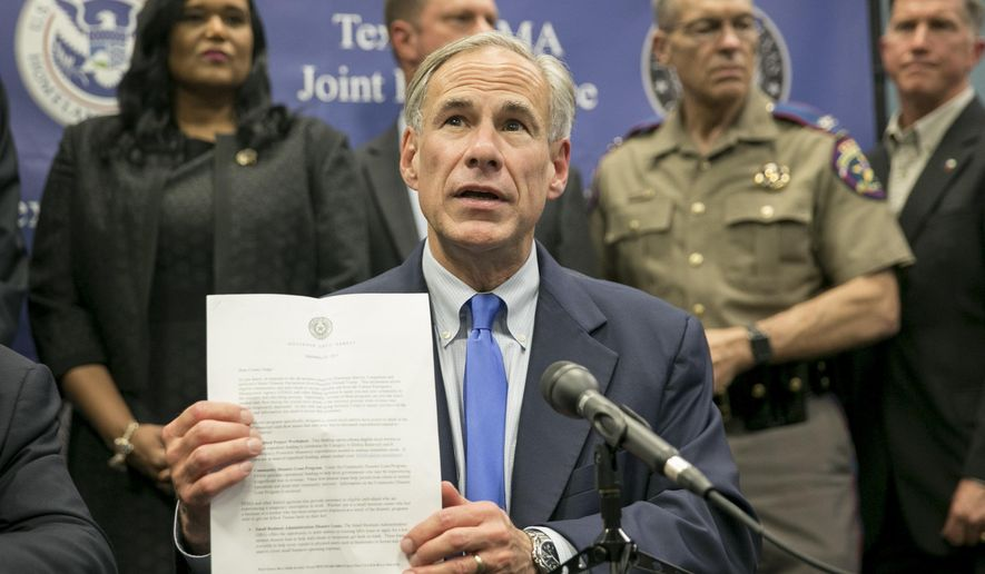 Texas Gov. Greg Abbott speaks about Hurricane Harvey recovery efforts at a news conference at the Texas FEMA Joint Field Office in Austin, Texas, on Tuesday Sept. 26, 2017. (Jay Janner/Austin American-Statesman via AP)