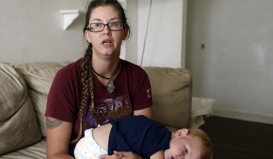 This Sept. 22, 2017 photo shows Shelby Hoogendyk and her 17 month-old son Caelan, at the St. Francis House in St. Augustine, Fla. Hoogendyk, her son and husband were evacuated from the homeless shelter during Hurricane Irma. When they arrived at a hurricane shelter they were segregated from the rest of the evacuees. Advocated for the homeless say the ill treatment of homeless people during disasters is a national problem that reflects the lack of state and local emergency planning to deal with that population. (AP Photo/Jason Dearen)