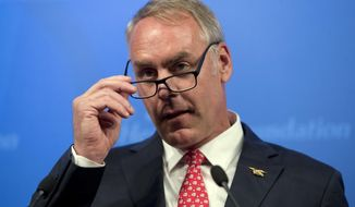 Interior Secretary Ryan Zinke speaks on the Trump Administration's energy policy at the Heritage Foundation in Washington, Friday, Sept. 29, 2017. (AP Photo/Andrew Harnik)