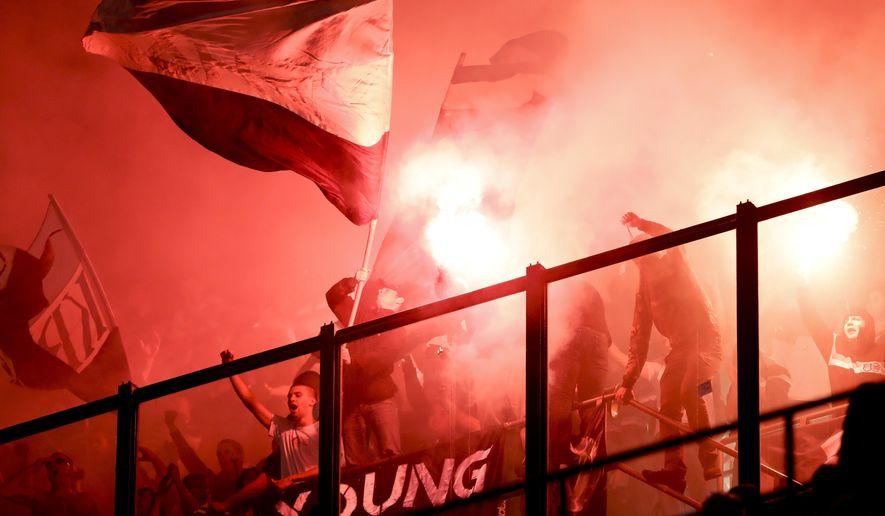 Rijeka fans light flares during the Europa League group D soccer match between AC Milan and Rijeka, at the Milan San Siro Stadium, Italy, Thursday, Sept. 28, 2017. (AP Photo/Luca Bruno)