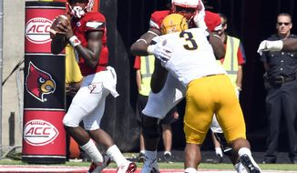 Louisville quarterback Lamar Jackson (8) drops back to pass during the first half of an NCAA college football game against Kent State, Saturday, Sept. 23, 2017, in Louisville, Ky. (AP Photo/Timothy D. Easley)