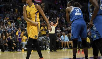 Los Angeles Sparks forward Candace Parker (3) celebrates after forcing a jump ball while defending against Minnesota Lynx forward Rebekkah Brunson (32) in the first half in Game 3 of a WNBA basketball finals game, Friday, Sept. 29, 2017, in Los Angeles. (Aaron Lavinsky/Star Tribune via AP)