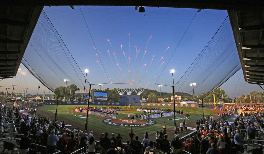 FILE - In this Aug. 20, 2017, file photo, the Pittsburgh Pirates and St. Louis Cardinals line the baselines, along with the 16 Little League teams from around the world participating in the Little League World Series Tournament that line the infield, for the national anthem before The Little League Classic baseball game between the Pirates and the Cardinals at Bowman Field in Williamsport, Pa. The New York Mets and Philadelphia Phillies will play on Aug. 19 at Bowman Field in Williamsport, under a change to next season's schedule announced Friday, Sept. 29, 2017. (AP Photo/Gene J. Puskar, File)