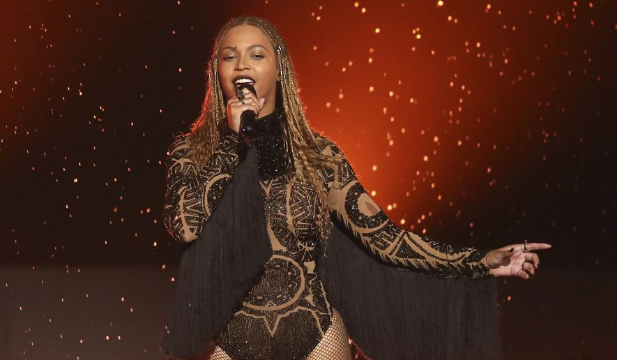 """In this June 26, 2016, file photo, Beyonce performs """"Freedom"""" at the BET Awards in Los Angeles. Beyonce released a surprise single Sept. 28, 2017, on which she sings in Spanish, English and French to raise relief money for those affected by hurricanes in the Caribbean and earthquakes in Mexico. (Photo by Matt Sayles/Invision/AP, File)"""