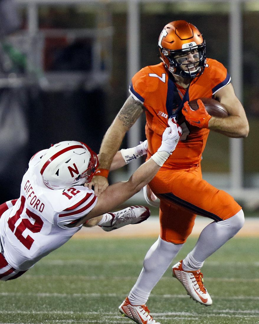 Illinois quarterback Chayce Crouch (7) tries to get away from Nebraska linebacker Luke Gifford (12) during the first half of an NCAA college football game Friday, Sept. 29, 2017, in Champaign, Ill. (AP Photo/Stephen Haas)