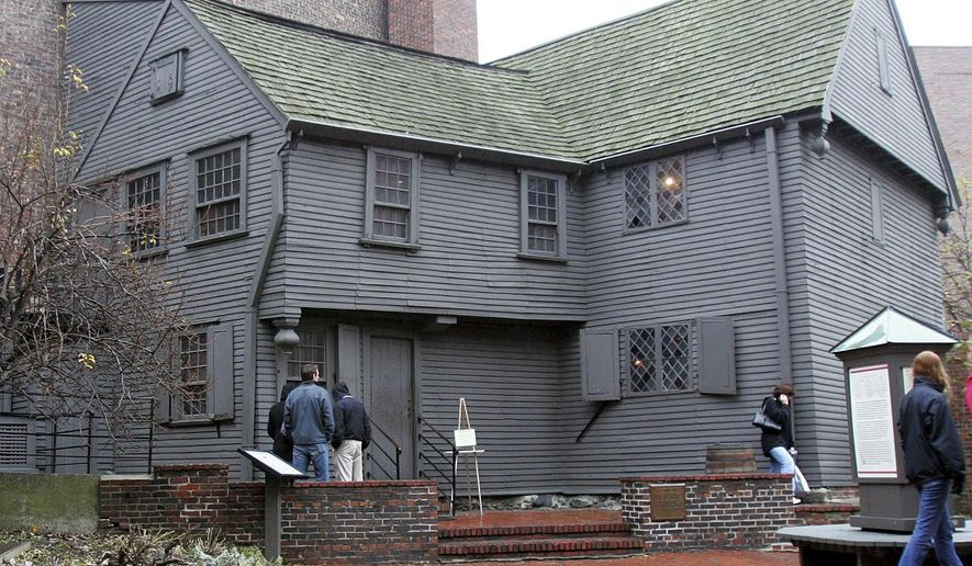 FILE - In this Nov. 24, 2004 file photo, tourists visit the Paul Revere House in the North End neighborhood of Boston. In 2017, archaeologists said they think they found where an outhouse was located next door to Revere's house in the yard of the Pierce-Hichborn House. Experts say the house, built next to Revere's house in 1711, was owned by one of Revere's cousins, and the renowned American patriot himself likely visited on numerous occasions. (AP Photo/Chitose Suzuki, File)