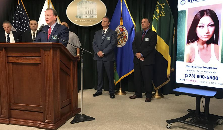 Los Angeles County Sheriff Jim McDonnell, at podium, discusses the arrest of a man on suspicion of killing a pregnant woman whose nude body was found on a beach in 1980, at a news conference in downtown Los Angeles Friday, Sept. 29, 2017. McDonnell said detectives arrested 65-year-old Robert Yniguez outside his home in the San Pedro area of Los Angeles Thursday. He is suspected of killing 20-year-old Teresa Boudreaux, seen at right, whose body was found on the shoreline of Malaga Cove Beach in Palos Verdes Estates in March, 1980. Sheriff's officials say Yniguez's DNA was linked to evidence that had been collected at the crime scene. (AP Photo/Michael Balsamo)