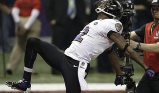 FILE - In this Feb. 3, 2013, file photo, Baltimore Ravens wide receiver Jacoby Jones (12) reacts after returning a kickoff for a over 100-yards for a touchdown during the second half of the NFL Super Bowl XLVII football game against the San Francisco 49ers in New Orleans. Jones will retire as a member of the Ravens on Friday, Sept. 30, 2017, the team for which he played his best football and earned a Super Bowl ring. (AP Photo/Elaine Thompson, File)