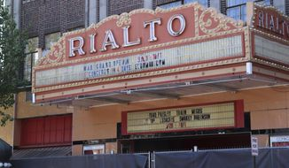 The Rialto Theater in downtown El Dorado, Ark., is shown on Friday, Sept. 29, 2017. The building will undergo a $32 million renovation as the second phase of the Murphy Arts District, as residents of the city create an entertainment hub in an effort to return to its glory years from nearly a century ago. (AP Photo/Kelly P. Kissel)