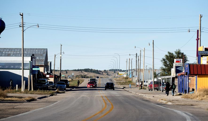 FILE- This Oct. 20, 2016 photo shows a view of Whiteclay, Neb. from the south looking north, on Route 87 in Whiteclay, Neb. The Nebraska Supreme Court on Friday, Sept. 29, 2017, rejected a last-ditch effort to resume beer sales in the tiny village next to an American Indian reservation in South Dakota that is plagued by alcohol problems. The court's ruling upholds an April decision by state regulators not to renew the licenses of four beer stores in Whiteclay, Nebraska. (Francis Gardler /The Journal-Star via AP, File)
