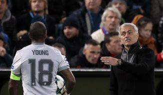 Manchester United coach Jose Mourinho, right, gives instructions to Ashley Young during the Champions League soccer match between CSKA Moscow and Manchester United in Moscow, Russia, Wednesday, Sept. 27, 2017. (AP Photo/Ivan Sekretarev)