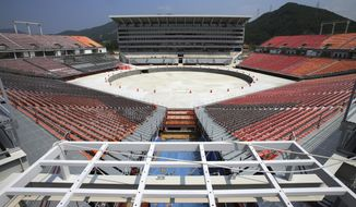 This June 29, 2017, photo shows a general view of the Pyeongchang Olympic Stadium under construction in Pyeongchang, South Korea. Construction has been nearly completed on the controversial stadium that will host the opening and closing ceremonies for the Pyeongchang 2018 Winter Games in South Korea. (Kim Kyung-mock/Newsis via AP)