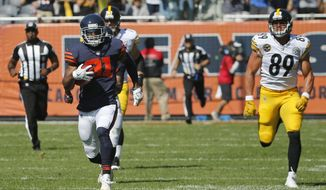 FILE - In this Sunday, Sept. 24, 2017, file photo, Chicago Bears cornerback Marcus Cooper (31) runs with the recovered ball after a blocked a field goal as Pittsburgh Steelers' Vance McDonald (89) chases during the first half of an NFL football game in Chicago. McDonald's chase down strip of Cooper last week stirred echoes of Don Beebe's sprint to catch Leon Lett in the Super Bowl a quarter century ago. McDonald is proud of his hustle, he just doesn't want to make it his signature play. (AP Photo/Charles Rex Arbogast, File)