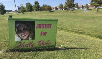 "This Sept. 25, 2017 photo, shows a sign that reads: ""Justice for Holly Bobo,"" in Parsons, TN. The town where Holly Bobo lived got some closure when Zachary Adams was convicted of kidnapping, rape and murder Bobo, a Tennessee nursing student. (AP Photo/Adrian Sainz)"