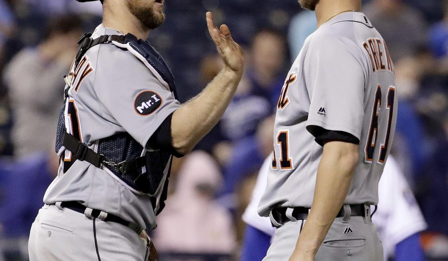 Detroit Tigers catcher Bryan Holaday, left, and relief pitcher Shane Greene (61) celebrate after a baseball game against the Kansas City Royals, Thursday, Sept. 28, 2017, in Kansas City, Mo. The Tigers won 4-1. (AP Photo/Charlie Riedel)