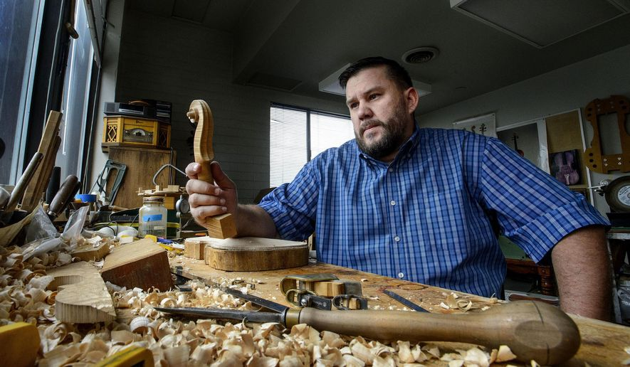 In a  Sept. 14, 2017 photo, violin maker Daniel Prier poses for a photo in his studio in Salt Lake City, Utah. Their professions might harken back to another era, but the Utahns who make their living via timeworn skills say they offer more life and energy than any office job could.  (Steve Griffin /The Salt Lake Tribune via AP)