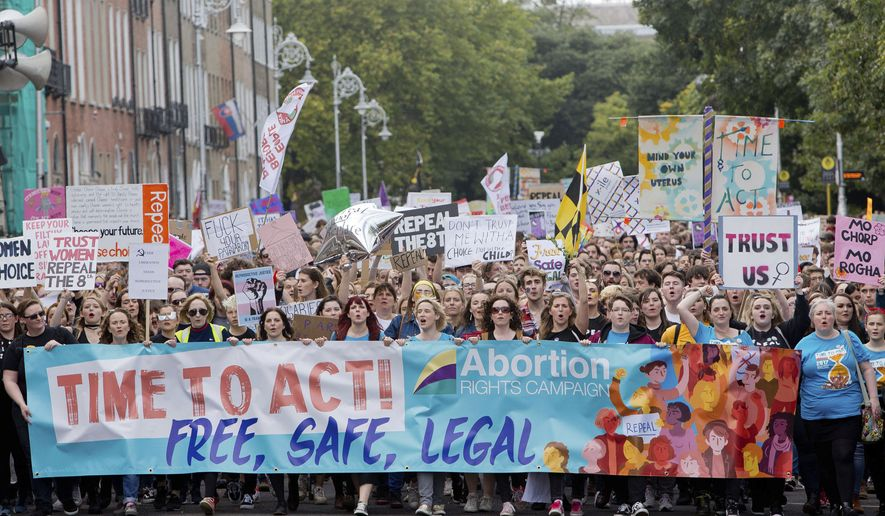 Demonstrators participate at The March for Choice event in Dublin, Ireland, calling for a change to Ireland's strict abortion laws Saturday Sept. 30, 2017.  The March for Choice is the first major demonstration on the abortion issue since the Government indicated it may accept a national referendum in summer 2018. (Tom Honan/PA via AP)