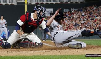 Minnesota Twins catcher Jason Castro tags out Detroit Tigers' Andrew Romine, after he tried to score from third on a single by Nicholas Castellanos during the fifth inning of a baseball game Saturday, Sept. 30, 2017, in Minneapolis. (AP Photo/Jim Mone)