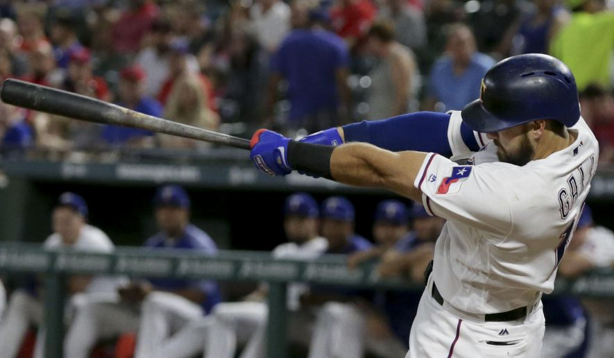 Texas Rangers Joey Gallo swings though a home run during the second inning of a baseball game against the Oakland Athletics in Arlington, Texas, Saturday, Sept. 30, 2017. (AP Photo/LM Otero)