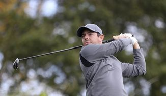 Northern Ireland's Rory McIlroy on the 2nd tee during day three of the British Masters at Close House Golf Club, Newcastle, England, Saturday, Sept. 30, 2017. McIlroy moved into contention at the British Masters by shooting a 6-under 64 in the third round of Saturday. (Owen Humphreys/PA via AP)