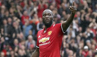 Manchester United's Romelu Lukaku, right, celebrates scoring his side's fourth goal of the game during the English Premier League soccer match between Manchester United and Crystal Palace at Old Trafford, Manchester, England. Saturday, Sept. 30, 2017. (Martin Rickett/PA via AP)