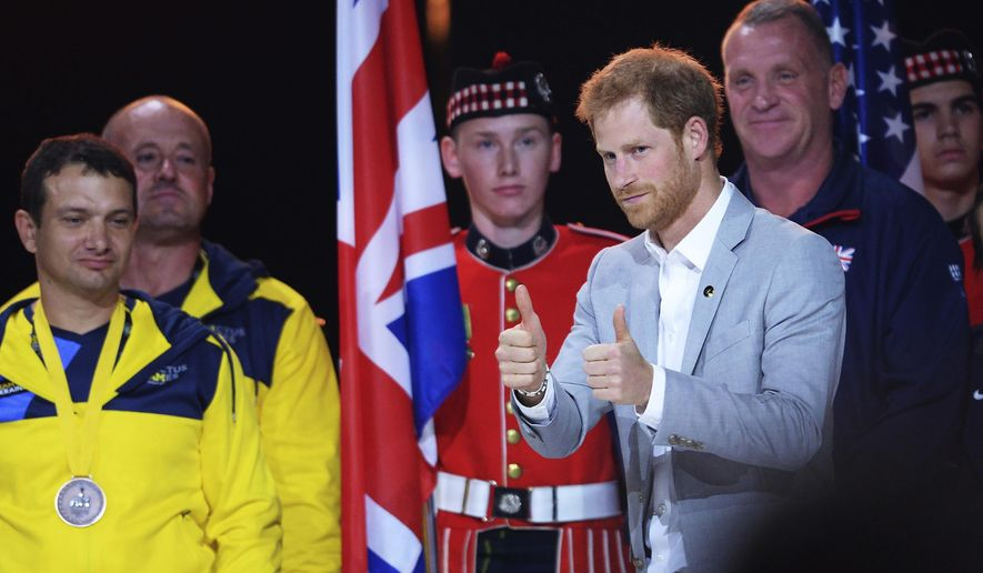 Prince Harry raises his thumbs-up as he hands out medals to athletes during the closing ceremonies of the Invictus Games in Toronto on Saturday, Sept. 30, 2017. (Nathan Denette/The Canadian Press via AP)