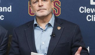 """FILE - In this July 26, 2017, file photo, Cleveland Cavaliers owner Dan Gilbert answer questions during an NBA basketball news conference at the team's training facility in Independence, Ohio. Gilbert says he received """"vile, disgusting"""" voicemails after LeBron James called President Donald Trump """"a bum"""" on Twitter. (AP Photo/Phil Long, File)"""