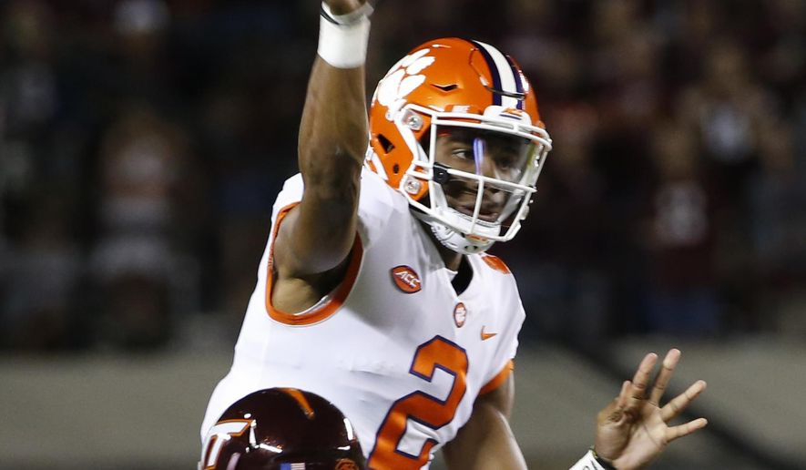 Clemson quarterback Kelly Bryant (2) tosses a pass as Virginia Tech cornerback Greg Stroman (3) closes in during the first half of an NCAA college football game in Blacksburg, Va., Saturday, Sept. 30, 2017. (AP Photo/Steve Helber)