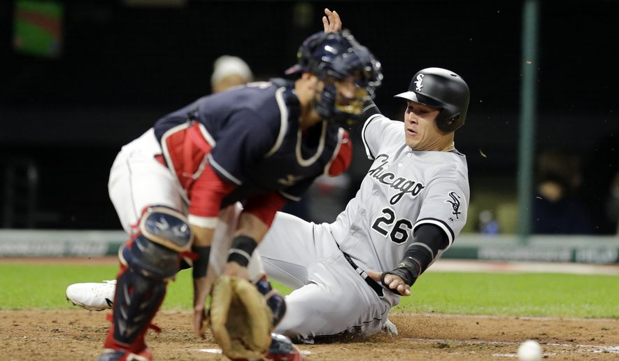 CORRECTS TO SIXTH INNING NOT FIFTH INNING - Chicago White Sox's Avisail Garcia (26) scores as Cleveland Indians catcher Yan Gomes waits for the ball in the sixth inning of a baseball game, Saturday, Sept. 30, 2017, in Cleveland. Garcia scored on a one-run double hit by Kevan Smith. (AP Photo/Tony Dejak)