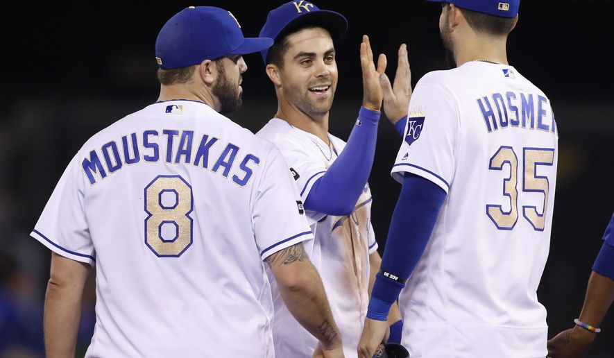 Kansas City Royals' Mike Moustakas, left, Whit Merrifield, center, and Eric Hosmer, right, celebrate their win over the Arizona Diamondbacks at the end of a baseball game at Kauffman Stadium in Kansas City, Mo., Friday, Sept. 29, 2017. (AP Photo/Colin E. Braley)