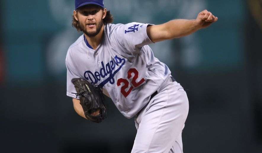 Los Angeles Dodgers starting pitcher Clayton Kershaw delivers a pitch to Colorado Rockies' Charlie Blackmon in the first inning of a baseball game Saturday, Sept. 30, 2017, in Denver. (AP Photo/David Zalubowski)