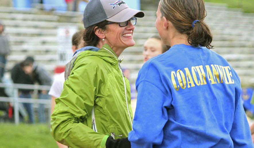 In this Sept. 14, 2017 photo, Saundra Hudson, left, an active member of and advocator for the Homer running community and teacher at Homer High School, talks with cross-country coach Annie Ridgley after completing the Mariner Mile, in Homer, Alaska. Those who know Saundra Hudson well would say that a mile race is nothing for the active member of the Homer running community. But after an accident last winter landed her in a Lower 48 medical facility, Hudson's first run in six months last Thursday was anything but trivial. (Megan Pacer/Homer News via AP)