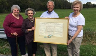 A 1742 deed for land owned by John, Thomas and Richard Penn, sons of Pennsylvania founder William Penn, is displayed at the site of the land it conveyed in Tulpehocken Township. Joel Zinn, center, donated the deed to the Andulhea Heritage Center in Rehrersburg. Also shown are (from left) are Sandra Kauffman, Judith Zinn and Dolores Hill. Kauffman is an Andulhea board member and Hill is its president. The deed was for the sale of 400 acres from Andulhea, the Penn family manor after which the center is named. (Ron Devlin /Reading Eagle via AP)