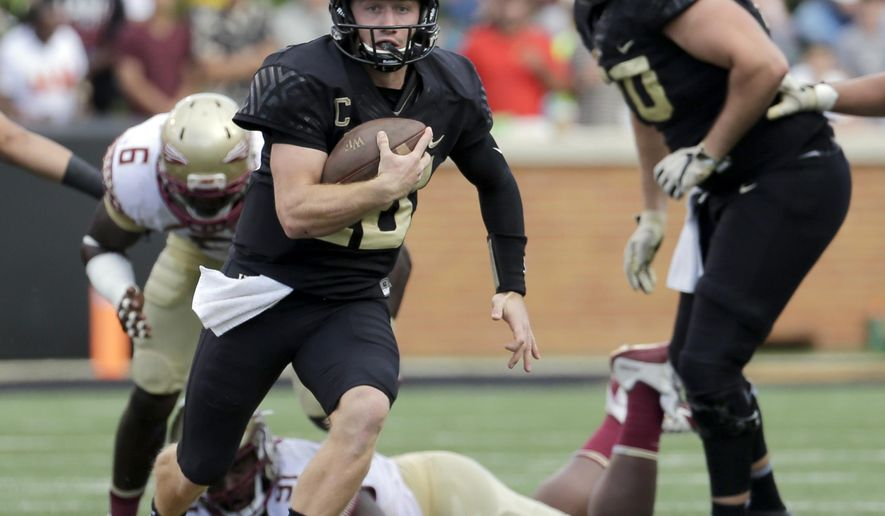 Wake Forest's John Wolford (10) runs against Florida State in the first half of an NCAA college football game in Winston-Salem, N.C., Saturday, Sept. 30, 2017. (AP Photo/Chuck Burton)