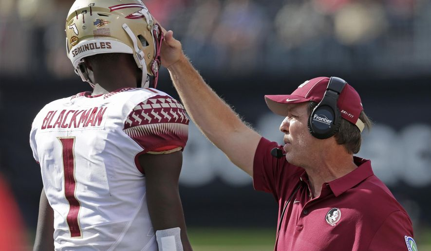Florida State head coach Jimbo Fisher, right, talks with James Blackman (1) in the first half of an NCAA college football gamea gainst Wake Forest in Winston-Salem, N.C., Saturday, Sept. 30, 2017. (AP Photo/Chuck Burton)