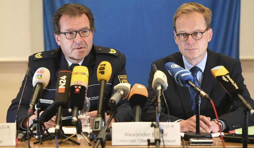 "Uwe Stuermer from the Konstanz police department, left,  and prosecutor  Alexander Boger speak during a press conference in Konstanz, Germany, Saturday, Sept. 30, 2017. German authorities have arrested a  man suspected of making threats to poison supermarket food unless a large payment was made. Police and prosecutors in the state of Baden-Wuerttemberg said the man arrested Friday is ""urgently suspected"" of attempted blackmail. (Felix Kaestle/dpa via AP)"