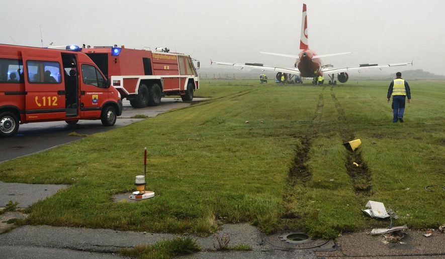 In this picture released by the fire brigade Westerland ( Freiwillige Feuerwehr Westerland), an Airbus of Air Berlin stands in a meadow near Westerland on the German North Sea island of Sylt, Saturday, Sept. 30, 2017. German authorities say the plane overshot the end of the runway  but nobody was injured in the incident. The regional emergency response center says the Air Berlin plane from Duesseldorf came to halt on grass about 50 meters beyond the end of the runway Saturday.  ( Joerg Elias/Freiwillige Feuerwehr Westerland/dpa  via AP)