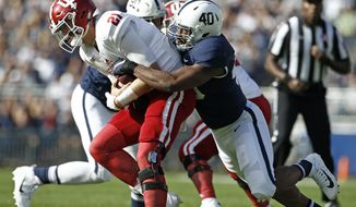 Penn State's Jason Cabinda (40) sacks Indiana quarterback Richard Lagow (21) during the first half of an NCAA college football game in State College, Pa., Saturday, Sept. 30, 2017. (AP Photo/Chris Knight)