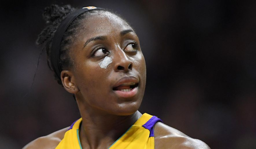 Los Angeles Sparks forward Nneka Ogwumike looks toward the scoreboard after receiving treatment for a cut on the face during the second half against the Minnesota Lynx in Game 3 of the WNBA basketball finals, Friday, Sept. 29, 2017, in Los Angeles. The Sparks won 75-64. (AP Photo/Mark J. Terrill)
